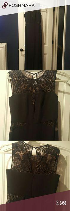 Bcbgmaxazria black lace cutout jumpsuit Black jumpsuit. Bcbgmaxazria lace cutout sides. Size 04. Wide legs. Never worn. BCBGMaxAzria Pants Jumpsuits & Rompers