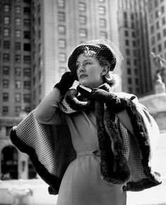 Geneviève Fath, wife of French stylist Jacques Fath, wearing one of his creations. New York – 1948. (Nina Leen/Time & Life Pictures/Getty Images)