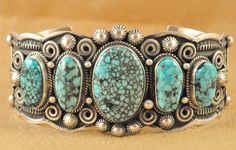 Handmade row cuff bracelet, with natural rare Kingman Turquoise, by Navajo artist Darrell Cadman.