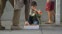 In the busy streets, shoppers and workers rush by the homeless little boy with a flute -- some dropping change, but most ignoring him. Sitting on the sidewalk in Istanbul, Turkey, his head is barely above knee height of the adults around him. But he plays on -- for hours, knowing that each coin or note can help his family survive another day. The flute is a cheap one, but it is key to their struggle. The money he makes -- usually about $10 a day -- will help feed his mom and four siblings.