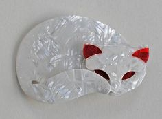 Lea Stein Cats #03 LEA STEIN GOMINA BROOCH This stunning pearly white cat, has red trim, measures 7cms across and the back has the 'V' shaped signed pin.