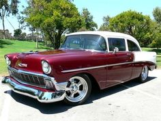 1956 Chevrolet 210 - Except for the mags and the 2 doors this looks just like the car Dad had when I took my driver's test in it. 265 V8, 3 spd column shift, white over burgundy. Dad's had the V8 emblem under the chevy badge, so this car was not originally a V8 car.