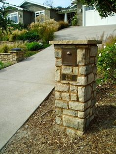 simple stone mailbox with large slate on top