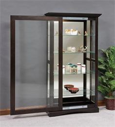 Eaton Collection This beautiful Mission style Curio Cabinet features an amazing large sliding glass door! This Amish furniture is sure to become - March 17 2019 at Glass Dresser, Glass Cabinet Doors, Sliding Glass Door, Glass Shelves, Sliding Doors, Entry Doors, Front Entry, Glass Doors, Wood Doors
