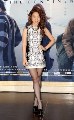 Hong Kong singer G.E.M. Tang poses as she arrives at the premiere for new movie 'The Continent' in Beijing, China, July 21, 2014