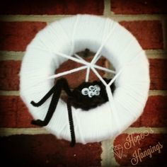 Spooky Spider Mini -Wreath!  7.8 in diameter, $10.00  The legs are fully adjustable. He looks so cute, oops... we meant to say scary, up on the wall.  www.etsy.com/shop/hopeshangings