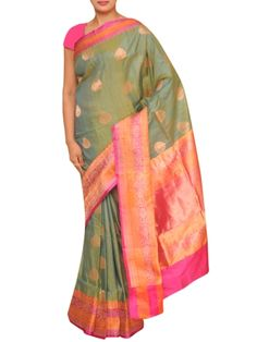 Details: Beautiful raw silk saree with pink and orange zari borders on melange dark green and booties all over is added to increase beauty and elegance www.ethnicroom.com