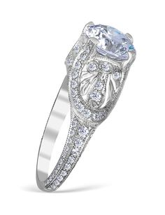 Whitehouse Brothers pave' special engagement ring mounting with 120 handset diamonds weighing 0.84 carat total weight.  You can expect the best from this excep