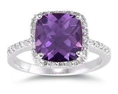 Thinking since my wedding colors are plum and gray I was thinking of getting a gemstone to match my wedding colors. Amethyst was close enough. I want my ring to tell a story and with this beautiful gemstone it will be a storyteller.    Cushion Cut Amethyst and Diamond Ring, 14K White Gold.