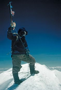 guardian:  Tenzing Norgay brandishes his ice axe on the summit of Mount Everest on 29 May 1953. Edmund Hillary took this photograph using a modest Kodak Retina compact camera loaded with Kodachrome colour film, he kept the camera tucked inside his jacket during the final ascent to keep it from freezing. Hillary apparently refused a photograph when Tenzing offered to return the favour  Photograph: Edmund Hillary/ Royal Geographical Society