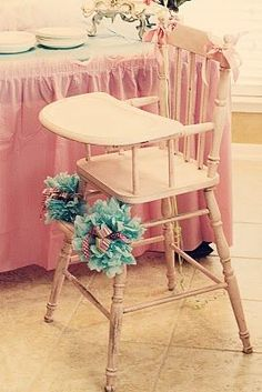 Old wooden high chairs. My first kid had to use one of these for a short time. Have to be careful to not hit the kid on the head with the wooden tray.