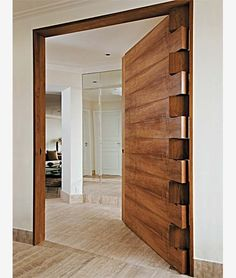 Absolutely love the hinge work and solid timber door. Would make an awesome front door. . I found website about #woodworking here: http://ewoodworkingprojects.com/ . Timber Front Door, Apartment Needs, Wooden Doors, Cool Furniture, Cotton Sheet Sets, Bed Sheet Sets, Modern Interior, Interior Designing, Doorway