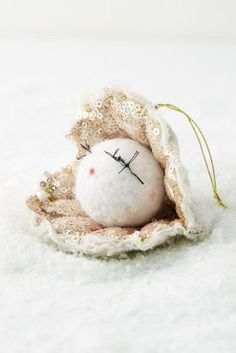 Anthropologie Oyster Ornament https://www.anthropologie.com/shop/orn-pearl-oyster?cm_mmc=userselection-_-product-_-share-_-39966569