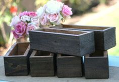 Imagine how pretty a mix of garden flowers and succulents might look in these Wooden Planter Boxes ($129).