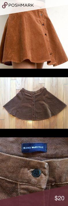 Brandy Melville Velour Circle Skirt Brandy Melville tan velour circle skirt with button-front. Brandy Melville Skirts Mini