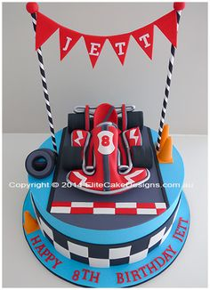 Unique boy's birthday cake featuring a hand sugarcrafted Go Kart