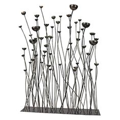 Prairie Grasses Metal Sculpture. Fraught with movement and line, this contemporary sculpture echoes the brilliantly beautiful tall grasses that silently echo across America's wide prairies. Willowy metal spires arch and reach for the sun in an artistic dance finished in a glossy, faux bronze finish. #prairiegrasses #metal #sculpture