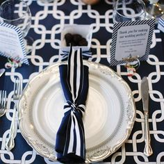 get striped fabric and cut ribbons to tie around napkins...cheap way to dress up the table