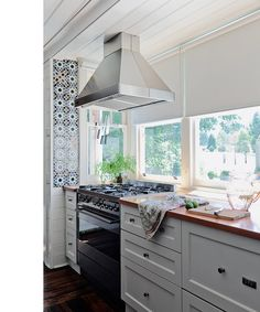 Pin inspired by @Bonnie Tsang. Kitchen of Kyneton Home of Vanessa Partridge, designed by Chelsea HIng. Moroccan tile, white cupboards, butcher block counters.