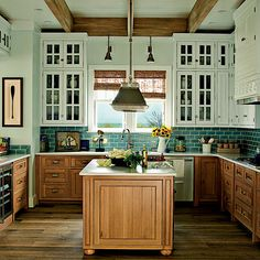 wood lower cabinets, white upper cabinets with glass fronts and teal subway tile backsplash