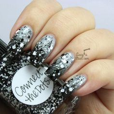 Gray and black Ombre with a twist. Give more life to your Ombre by adding silver sequins on top of the nails in varying sizes.