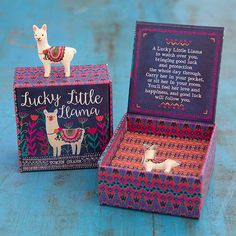 "Llama Lucky Charm - Carry a little luck with you every day! This adorable resin llama charm comes in a decorated and ready-to-give paper box with ""To/From"" on the bottom and the charm story on the inside."