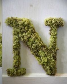 This one is covered in moss, but monogram's are always a nice personal touch. (carnations, daisies, and roses keep it simple and less expensive if you want flowers. Or sometimes the right greenery will do the trick)