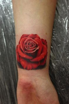 Red Rose Wrist Tattoo - John Anderton http://tattoosflower.com/red-rose-wrist-tattoo-john-anderton/