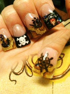 Pirate nails, love the ring finger. This girl needs lotion!