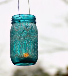 Hand Painted Mason Jar Lantern, with Peacock Blue Glass and Pearl White Eccents. $24.00, via Etsy.