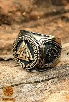 Futhark, or runic alphabet, goes around Valknut. The runic alphabet is a collection of magical symbols. The runes have names, phonetic and magical meanings.  The rings sides feature stylized dragons in a knot pattern.  #magicrebel #bronze #valknut #futhark #runes #odin #nordic #amulet #adjustable #size #ring
