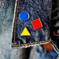 """This triple pin combo can be rearranged, worn all together or independently. Inspired by a trip to Berlin's Bauhaus Archive, these geometric shapes are the foundation for all other shapes and follow Kandinsky's theory on color. - Sold as a set of three - Soft enamel - Each pin measures .5"""" - Designed and packed by hand in Chicago"""