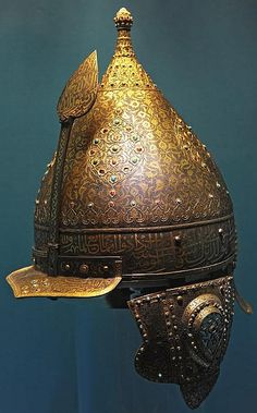 Chichak, a type of helmet (migfer) originally worn in the 15th-16th century by cavalry of the Ottoman Empire, consisting of a rounded bowl with ear flaps, a peak with a sliding nose guard passing through the peak, and an extension in the back to protect the neck. Various other countries used their own versions of the chichak including Mughal India, in Europe the zischagge helmet was a Germanisation of the original Turkish name. Mid-16th century, iron, gold, rubies, turquoise.