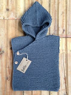 Fable Baby – Organic cotton 'Hoodie' vest, dark grey. Organic Cotton Yarn from Peru. Hand Knitted in Melbourne. • See more at The Big Design Market on 6/7/8 December 2013 – Royal Exhibition Building, Melbourne.  www.thebigdesignmarket.com