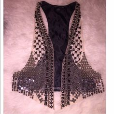 Nude & black beaded vest by foreign exchange Beautiful beading in like new condition. Looks like the all saints inspired vest. Pairs perfect with all black jeans and heels.  Foreign Exchange Jackets & Coats Vests