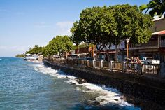 Front Street in historical Lahaina. I love the old town atmosphere here where there is lots of shopping and restaurants. Beautiful views. Cool Banyon Tree park.