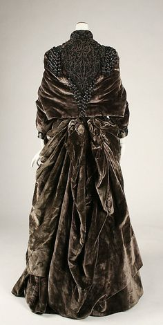 Ensemble Date: ca. 1882 Culture: American Medium: (a,b,c) silk (d) feathers. Marking: [label] (in bonnet) PARIS/EWM/ 58 East 10th St New York USA (E.M.Walsh): [label] (in dress) Josephine Egan no. 56 East 10th St. New York. Back