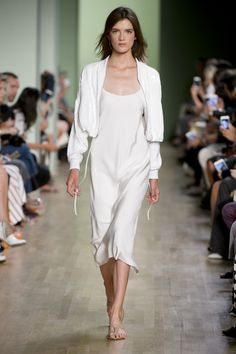 Tibi Spring 2016: A white sequined bomber jacket worn over a silk slipdress adds subtle shine to a sleek look.