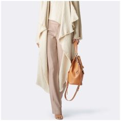 """Ralph Lauren Pants First pic of model wearing this style of Pants. Last 3 pics are of actual item/color. Tan Color. 6P and made of 54% Silk and 46% Cotton. Inseam is 28.  Rise """"9.5. Length """"38. Laying flat is """"14.5 (waist 29). This item is not new, It is used. These Pants are Authentic and from a Smoke And Pet free home. All Offers through the offer button ONLY. I Will not negotiate Price in the comment section. Thank You😃 Ralph Lauren Pants"""