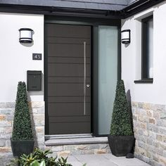 Charcoal Grey Newmarket Modern External Door A modern door that offers all the features of a beautiful timber door but with the added benefit of being manufactured with a composite core. This door has a stunning emobosed timber grain whic Contemporary Front Doors, Modern Door, Timber Door, Wood Doors, Grey Doors, External Doors, Grey Houses, Entrance Doors, Home Reno