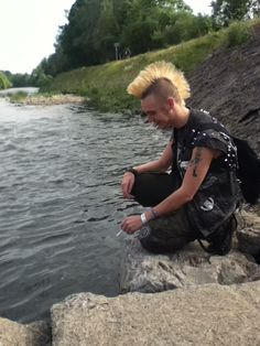 Punk guy with mohawk by stream