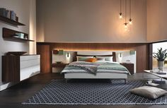"""The new huelsta """"Lunis"""" bedroom collection offers the latest in minimalistic, Bauhaus-inspired design. Different combinations of headboard and bed frames finished in a variety of fabrics or leathers are visually striking. Matching wardrobes, sideboards, and nightstands complete the ensemble!"""