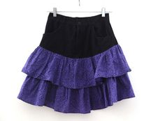 Vintage 80's skirt with  purple ruffle bottoms and  print black top