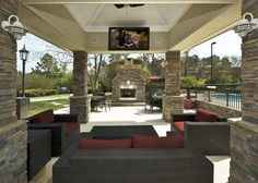 Outdoor Living Room featuring HDTV, fireplace and BBQ grill.