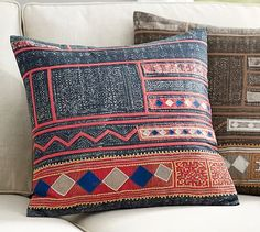 The boho look of vintage dyed textiles is paired with contrasting colors and then embroidered for a chic pillow cover with a casual, eclectic feel. Style your seating area with this and shibori prints.