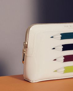 SHOP CBN: Beautifully illustrated and perfectly proportioned the HADIA wash bag is pretty and practical to the letter. With a plenty of space to carry your beauty essentials, this is one to pencil in your new-season checklist.
