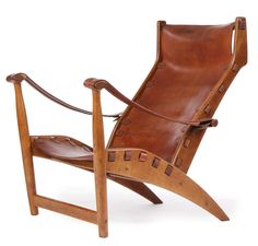 Rare oak framed Copenhagen Lounge by Mogens Voltelen with saddle leather seat and back held on with straps and buckles. Crafted by Niels Vodder.