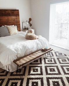Reclaimed timber headboard, oodles of natural light, neutral linen and cute pup! Love this space.