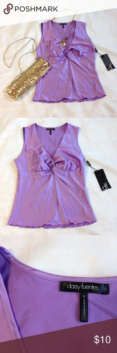 Purple Sleeveless Blouse by Daisy Fuentes Beautiful New With Tags Purple Sleeveless Blouse by Daisy Fuentes.  (Does not include necklace and purse). Approx. Measurements: Bust 34 inches (All-around) Waist 30 inches (All-around) Front Length 21 inches (From shoulder to bottom) Shoulder to shoulder 12 1/2 inches  🌟I also offer 15% Off 2+ bundle 🌟🎄December promotion only!🎄 Daisy Fuentes Tops Blouses