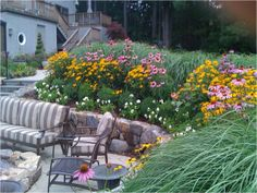 John's Landscape Service designed and installed a dramatic landscape complete with year-round blooms. #landscape #annuals #plantings